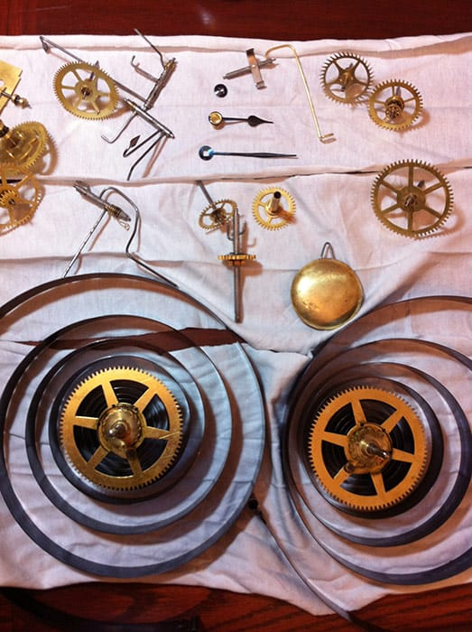 Seth Thomas clock movement dismantled on table
